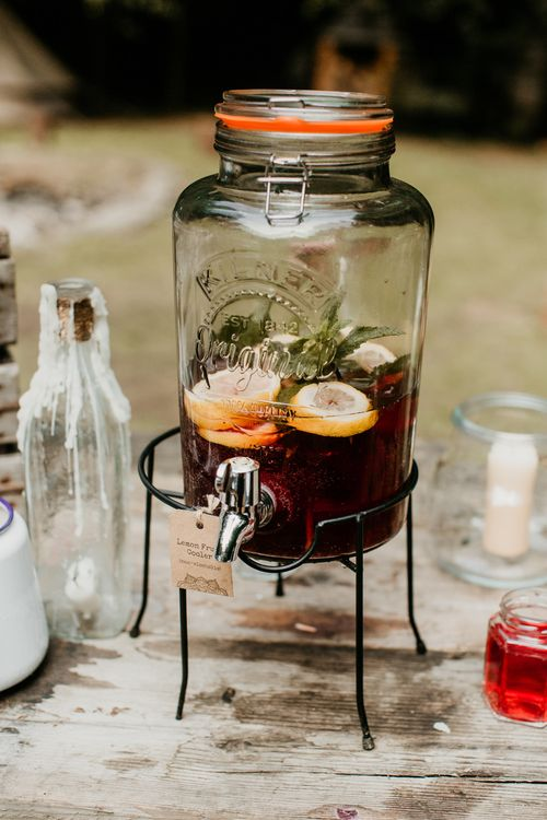 Drinks Dispenser | Burgundy Outdoor Woodland Ceremony & Country Tipi & Horse Bar Reception at The Ancient Woodland, Hertfordshire, Planned & Styled by Caroline Hitchcock Events | Alex Wysocki Photography | DgtlCouture Film