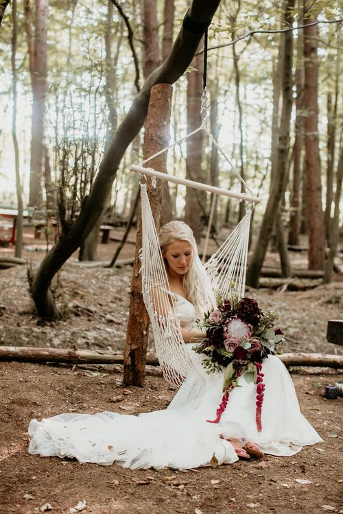 Bride in Maggie Sottero Gown | Burgundy Outdoor Woodland Ceremony & Country Tipi & Horse Bar Reception at The Ancient Woodland, Hertfordshire, Planned & Styled by Caroline Hitchcock Events | Alex Wysocki Photography | DgtlCouture Film