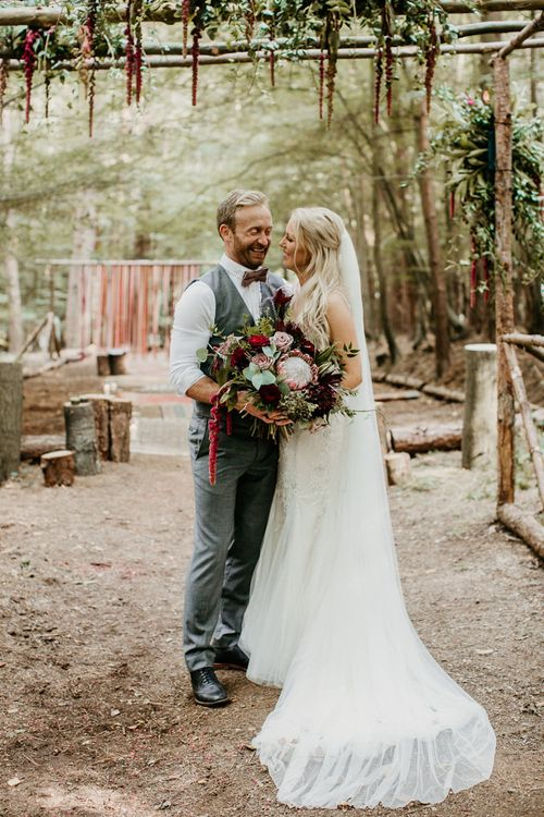 Bride in Maggie Sottero Gown | Groom in  Waistcoat | Burgundy Outdoor Woodland Ceremony & Country Tipi & Horse Bar Reception at The Ancient Woodland, Hertfordshire, Planned & Styled by Caroline Hitchcock Events | Alex Wysocki Photography | DgtlCouture Film