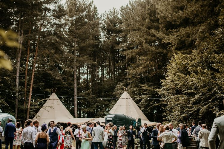Country Tipi's Reception | Burgundy Outdoor Woodland Ceremony & Country Tipi & Horse Bar Reception at The Ancient Woodland, Hertfordshire, Planned & Styled by Caroline Hitchcock Events | Alex Wysocki Photography | DgtlCouture Film