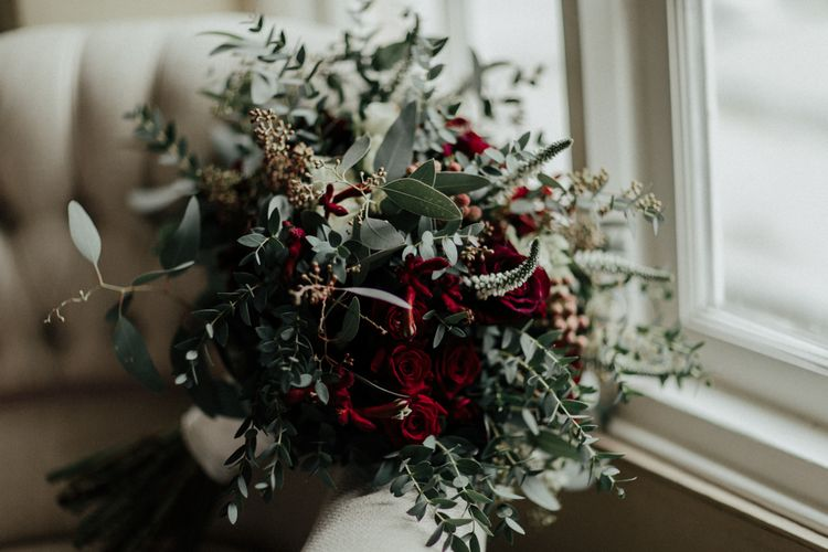 Winter Wedding Bouquet with Red Flowers and Foliage