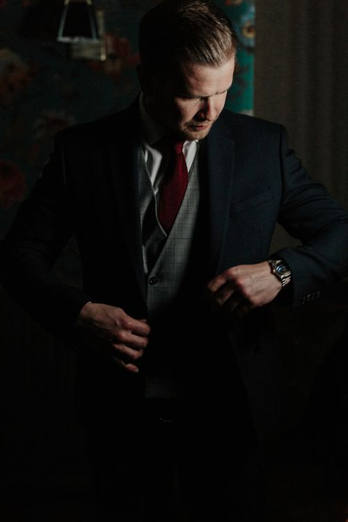 Groom in Navy Marks and Spencer Suit with Check Waistcoat and Deep Red Tie