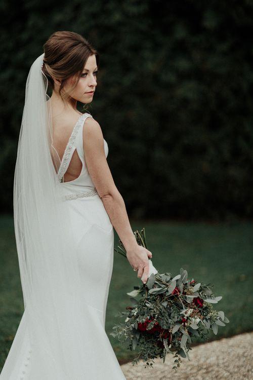 Bride in Essense of Australia Wedding Dress with Low V Back