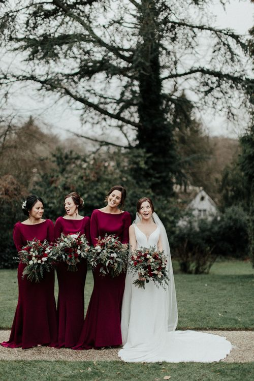 Bridal Party with Bridesmaids in Burgundy Dresses and Bride in Essense of Australia Wedding Dress