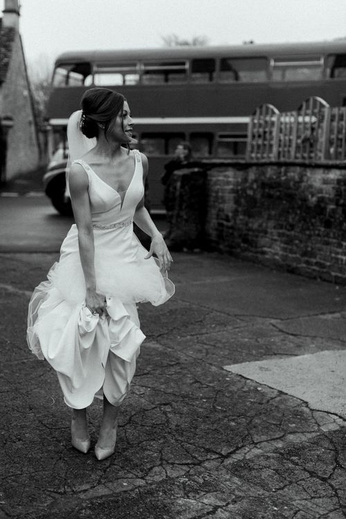 Bride in Essense of Australia Wedding Dress with Straps and Cathedral Length Veil