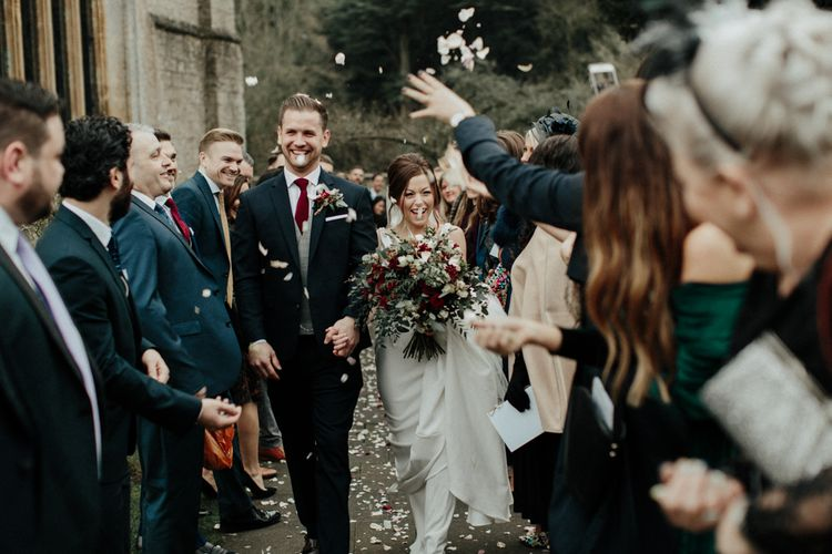 Confetti Moment with Bride in Essense of Australia Wedding Dress and Groom in Marks and Spencer Suit
