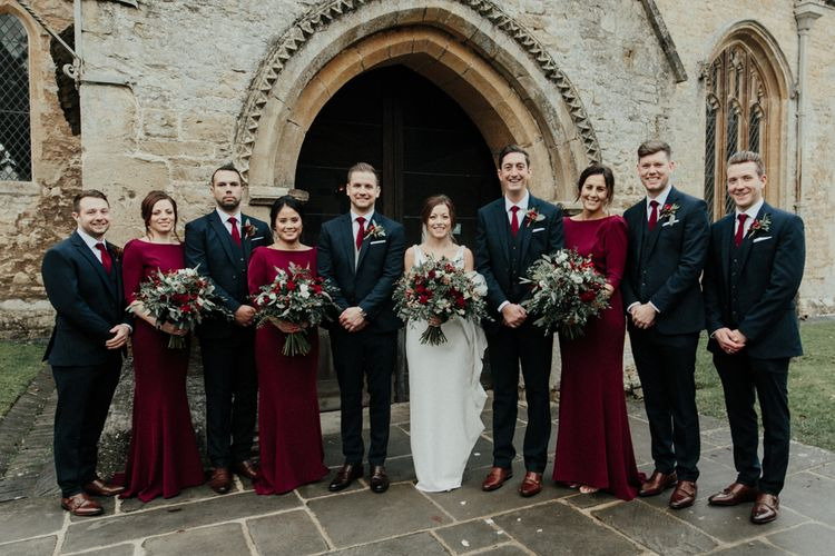 Wedding Party Portrait with Bridesmaids in Red Dresses, Bride in Essense of Australia Wedding Dress and Groomsmen in Marks and Spencer Suits