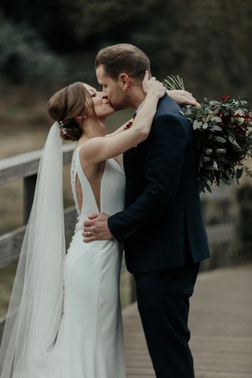 Bride in Essense of Australia Wedding Dress and Cathedral Veil and Groom in Marks and Spencer Suit