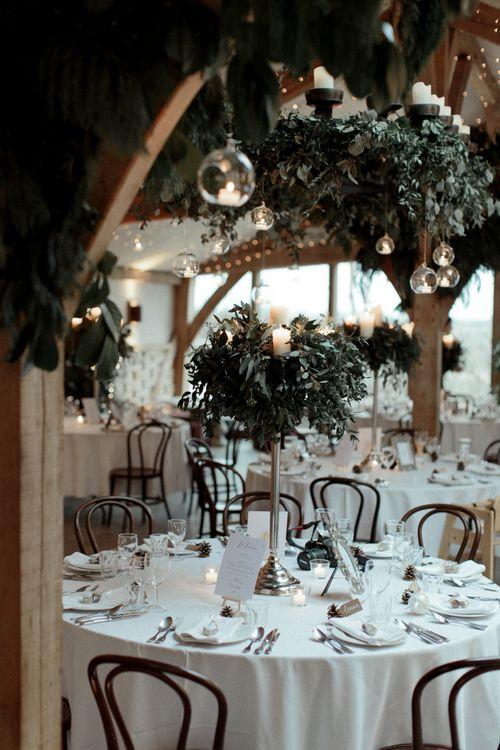 Cripps Barn wedding Reception Decor with Hanging Votives and Candelabra Centrepiece