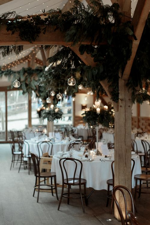 Cripps Barn wedding Reception Decor with Foliage and Candle Light