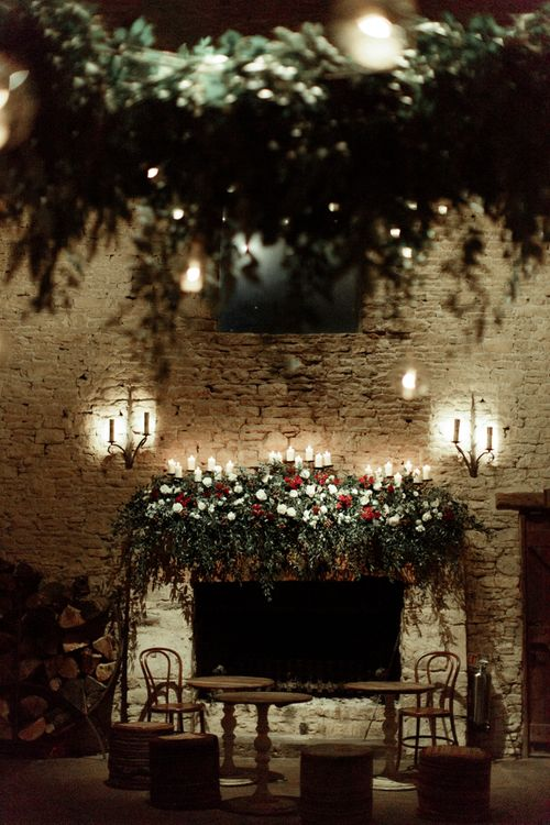 Foliage, Red Flowers and Candle Light Fireplace Arrangement