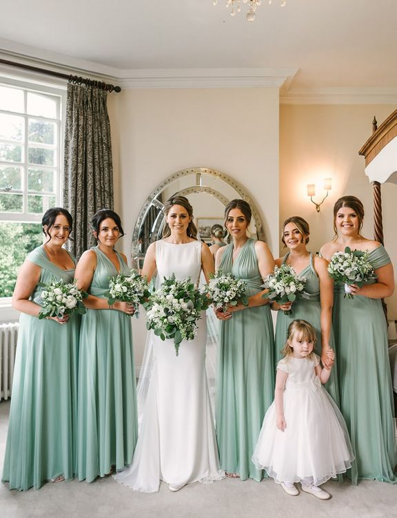 Bridal Party Portrait with Bridesmaids in Pale Green Multiway Dresses and Bride in Pronovias Wedding Dress