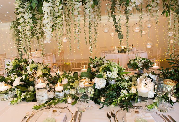 White Wedding Flowers and Foliage Table Decor with Candles