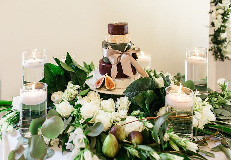 Cheese Tower Surrounded by White Flowers, Foliage and Candles