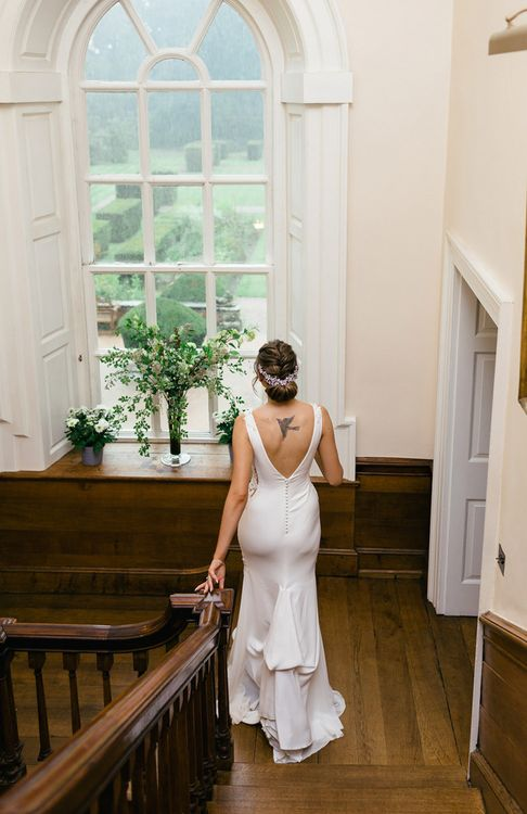 Bride in Fitted Pronovias Wedding Dress with Buttons Down the Back