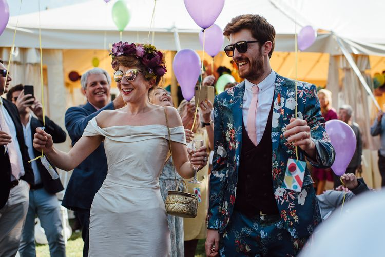 Balloon Release For Wedding // Secret Garden Party Inspired Wedding France Bride In Large Faux Floral Crown And Glitter Station With Groom In Floral Print Suit & Images From The Shannons