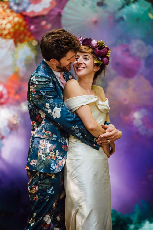 Colourful Parasol Photo Backdrop For Wedding // Secret Garden Party Inspired Wedding France Bride In Large Faux Floral Crown And Glitter Station With Groom In Floral Print Suit & Images From The Shannons
