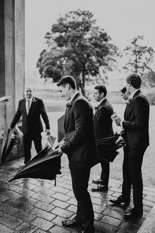 Groomsmen Holding Umbrellas