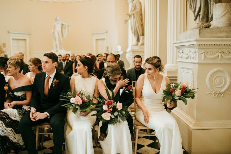 Bridesmaids in White Dresses During The Wedding Ceremony