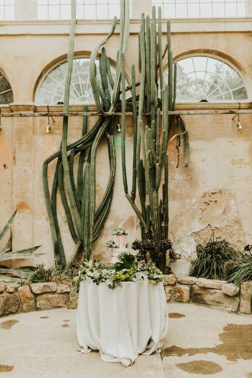 Wedding Cake Table with Botanical Plant Backdrop