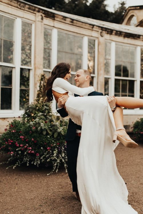 Groom Lifting His Bride Up