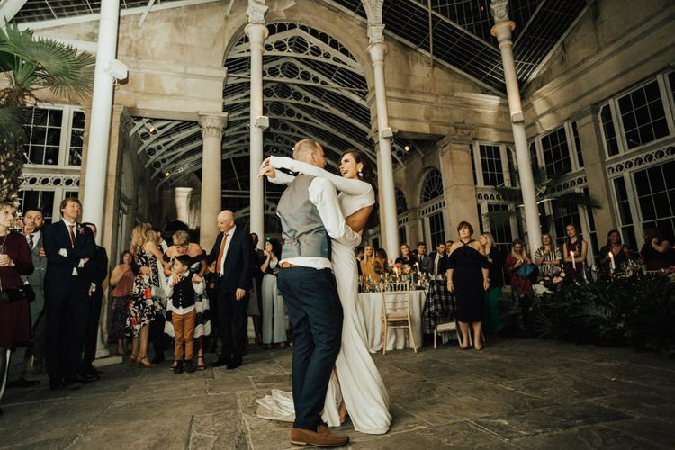 Bride and Groom Embracing During Their First Dance