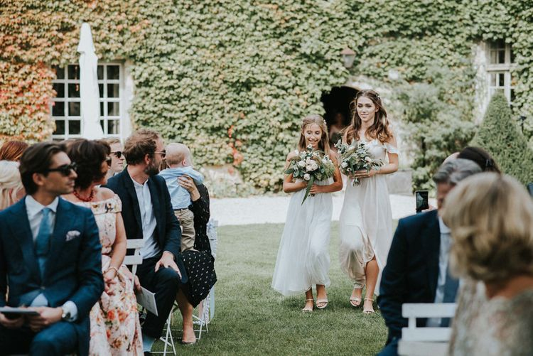 Bridesmaids In White Dresses With Rustic Organic Feel Oversized Bouquets