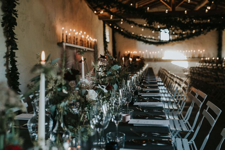 Atmospheric Wedding Reception With Candles And Bud Vase Floral Arrangements