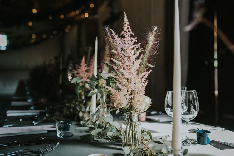 Pink Astilbe And Tall Tapered Candles For Wedding Reception