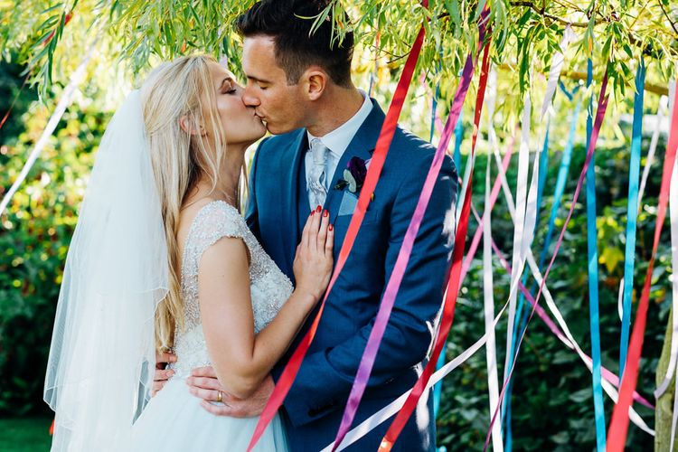 Ribbon Wedding Decor | Bride in Beaded Bodice Gown | Groom in Blue Reiss Suit | Bright DIY 'At Home' Outdoor Garden Ceremony & Marquee Reception | Marianne Chua Photography