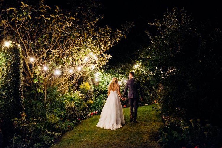 Festoon Lights | Bride in Beaded Bodice Gown | Groom in Blue Reiss Suit | Bright DIY 'At Home' Outdoor Garden Ceremony & Marquee Reception | Marianne Chua Photography