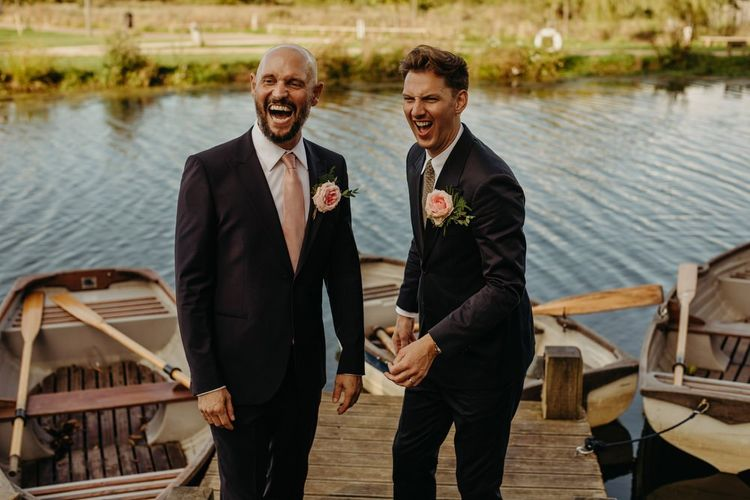 Mr and Mr Laughing by the boats