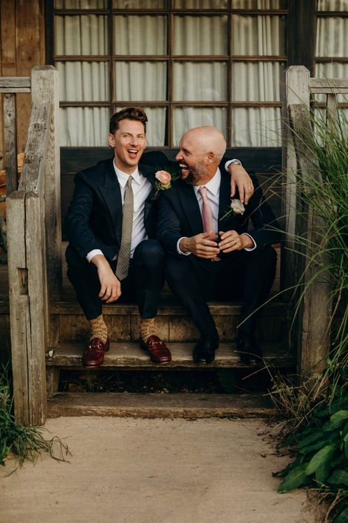 Two Grooms Embracing for Wedding Portrait