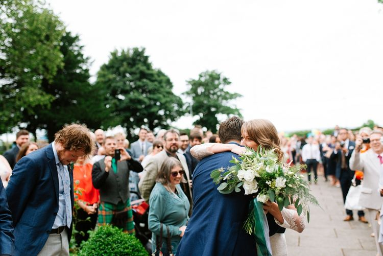 Bride & Groom Meet in Church Courtyard | Fun Stretch Tent Reception on Primary School Field in Sheffield |  Tub of Jelly Photography