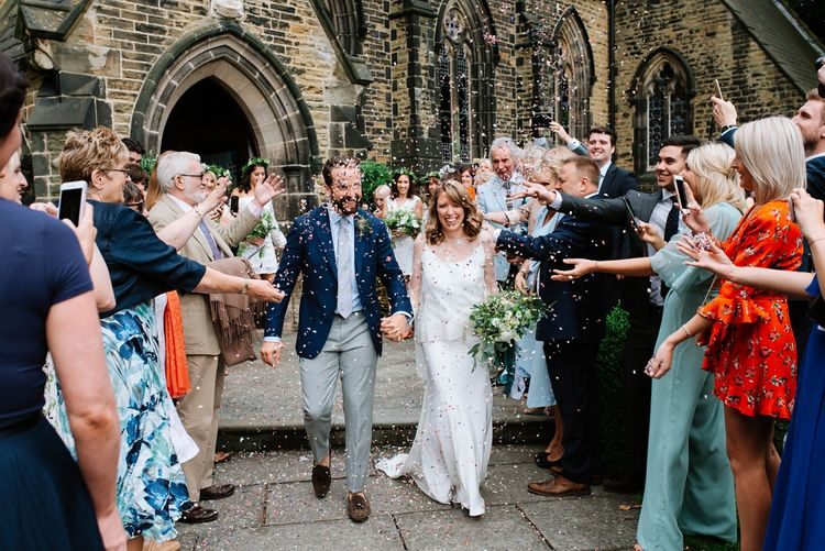 Confetti Exit | Bride in Delphine Manivet Gown | Groom in Navy Blazer & Grey Trousers | Fun Stretch Tent Reception on Primary School Field in Sheffield |  Tub of Jelly Photography