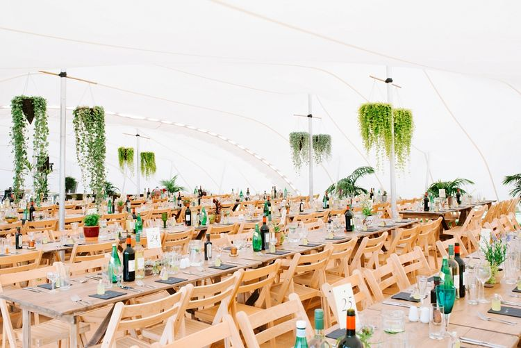 Trestle Tables & Hanging Plant Decor | Fun Stretch Tent Reception on Primary School Field in Sheffield |  Tub of Jelly Photography