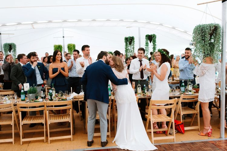 Bride in Delphine Manivet Gown | Groom in Navy Blazer & Grey Trousers | Fun Stretch Tent Reception on Primary School Field in Sheffield |  Tub of Jelly Photography