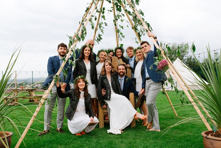 Wedding Party with Leather Jackets | Naked Tipi Wedding Decor | Bride in Delphine Manivet Gown | Groom in Navy Blazer & Grey Trousers | Fun Stretch Tent Reception on Primary School Field in Sheffield |  Tub of Jelly Photography