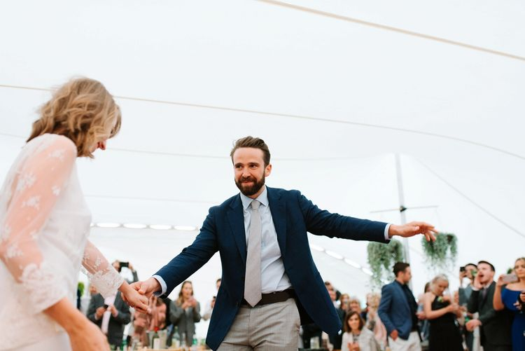 First Dance | Bride in Delphine Manivet Gown | Groom in Navy Blazer & Grey Trousers | Fun Stretch Tent Reception on Primary School Field in Sheffield |  Tub of Jelly Photography