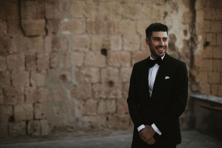 Groom in Made to Measure Tuxedo Suit by Oscar Hunt   Black Aquila Shoes   Intimate Italian Castle Wedding with Prosecco Tower   James Frost Photography