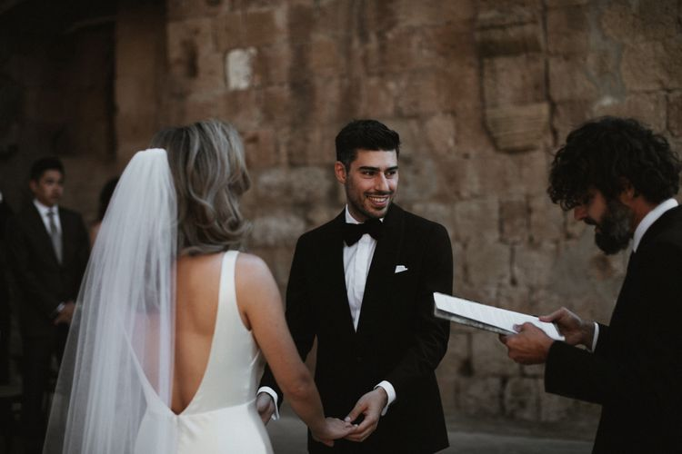 Wedding Ceremony   Bride in Silk Pallas Couture Wedding Dress with Plunging Neckline and Side Split   Roman & French Cathedral Veil   Groom in Made to Measure Tuxedo Suit by Oscar Hunt   Intimate Italian Castle Wedding with Prosecco Tower   James Frost Photography