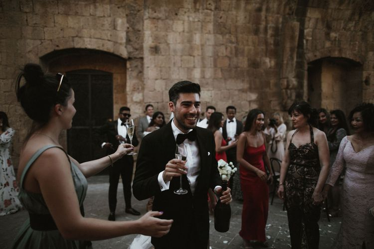 Just Married   Champagne   Groom in Made to Measure Tuxedo Suit by Oscar Hunt   Intimate Italian Castle Wedding with Prosecco Tower   James Frost Photography