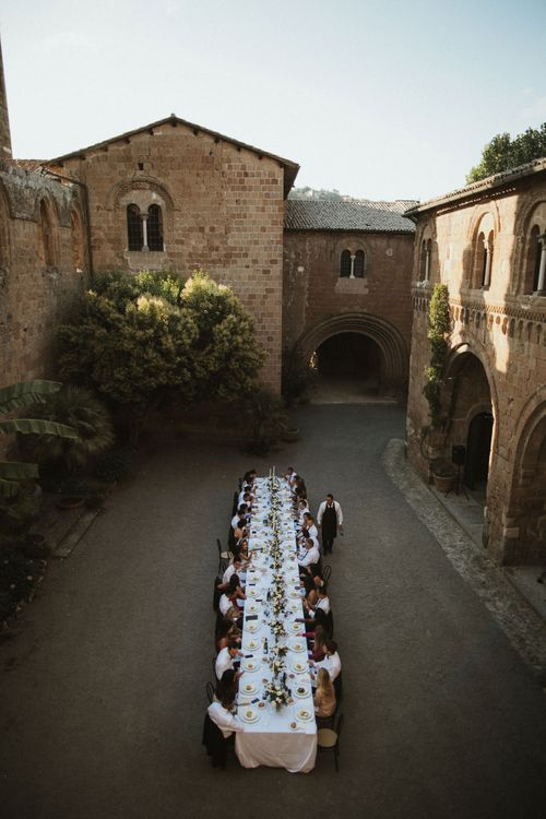Wedding Reception   Wedding Breakfast Table in Courtyard at La Badia Di Orvieto Italy   Intimate Italian Castle Wedding with Prosecco Tower   James Frost Photography