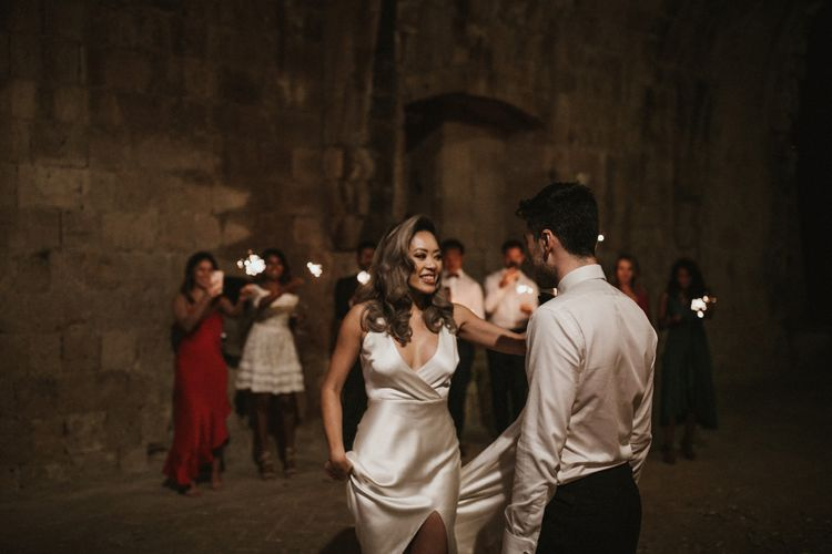 First Dance   Wedding Sparklers   Bride in Silk Pallas Couture Wedding Dress with Plunging Neckline and Side Split   Groom in Made to Measure Tuxedo Suit by Oscar Hunt   Intimate Italian Castle Wedding with Prosecco Tower   James Frost Photography