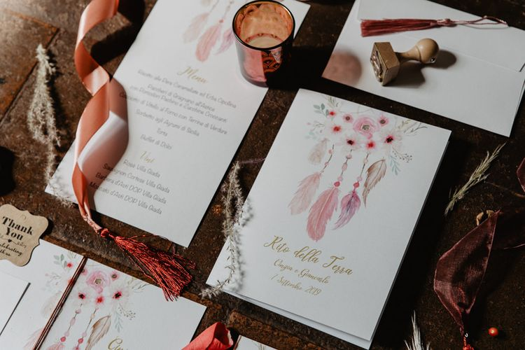 Feather wedding stationery for Italian wedding with flower centrepieces