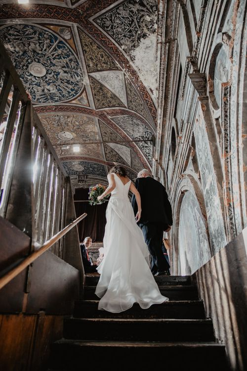 Bride makes her way to Italian wedding ceremony