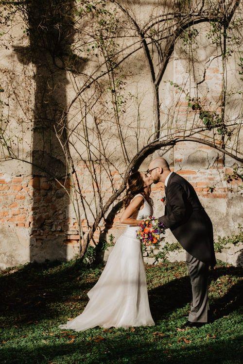 Groom wears tail suit for Italian wedding