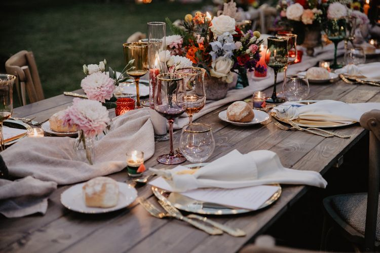Wedding table decor with flower centrepieces and candles