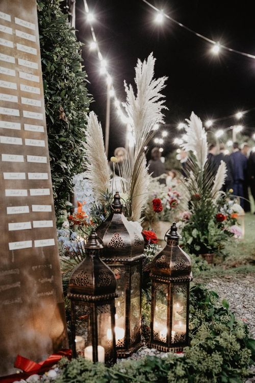 Pampas grass wedding decoration with bright wedding flowers and flower centrepieces