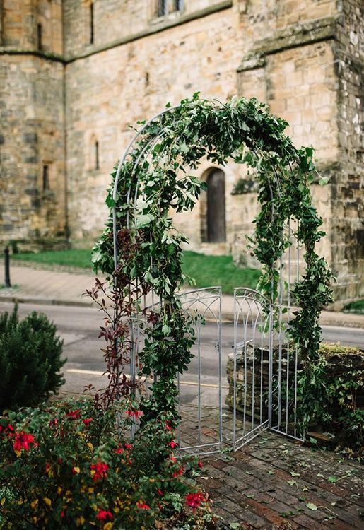 Archway with foliage decor at East Sussex venue for winter celebration